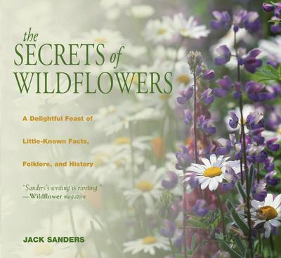 "Book cover with faded image of white and purple flowers. Text reads ""The Secrets of Wildflowers - A Delightful Feast of Little-Known Facts, Folklore and History by Jack Sanders"